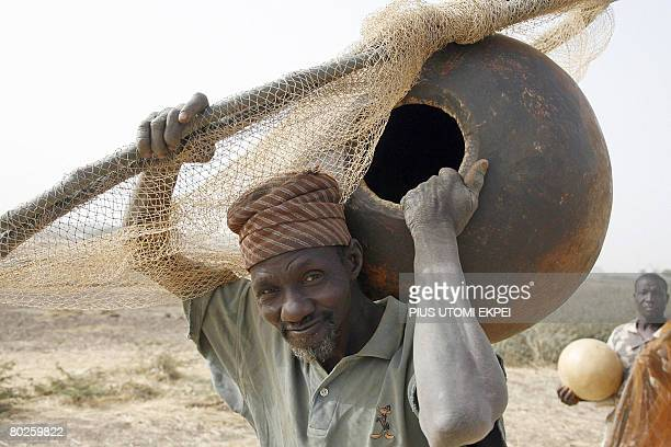 An elderly fisherman arrives on March 15 2008 at Argungu River in Argungu northwestern Nigeria to participate in the yearly fishing festival Over...