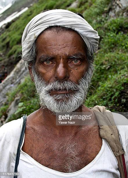 An elderly Hindu man makes his pilgrimage to the sacred Amarnath Caves one of the most revered of Hindu shrines on June 29 2011 near Baltal Jammu and...