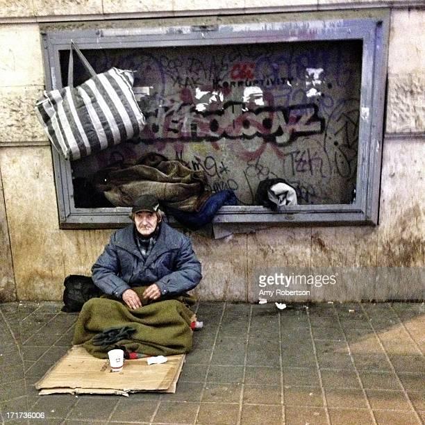 CONTENT] BUDAPEST HUNGARY NOVEMBER 2010 An elderly homeless man begs for money in downtown Budapest Hungary on November 17 2012