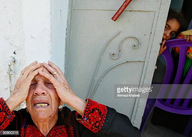 An elderly homeless Palestinian woman, Al-Hajja Fatma cries while sitting near her home which was destroyed by the Israeli Army in a recent raid May...