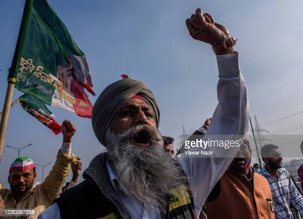 An elderly Indian farmer shouts anti government slogans during a protest against new farm laws on December 13, 2020 at the Delhi-Uttar Pradesh border...