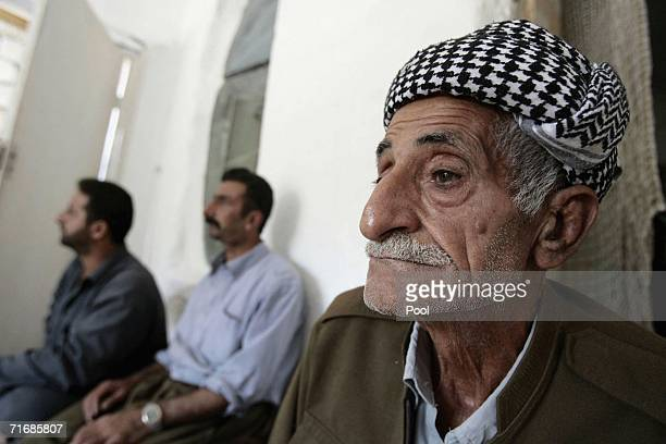 An elderly Iraqi Kurd man sits with his family in the fortress which was allegedly formerly used by the Iraqi Army to interrogate and torture Kurds...