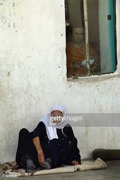 An elderly Iraqi Kurd woman sits on a balcony at the fortress which was allegedly formerly used by the Iraqi Army to interrogate and torture Kurds...