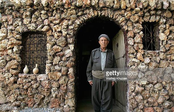 An elderly Iraqi Kurdish man stands in front of a museum on November 6 2007 in Dauhk city situated close to the Iraqi/Turkish border about 300 miles...