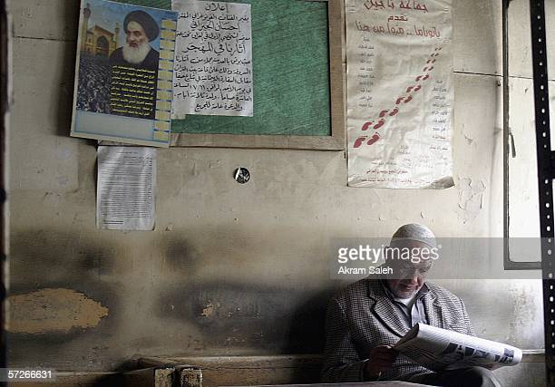 An elderly Iraqi man reads a local newspaper at a tea shop on April 6 2006 in Baghdad Iraq According to the US Military Muhammed Hila Hammad Ubaydi a...