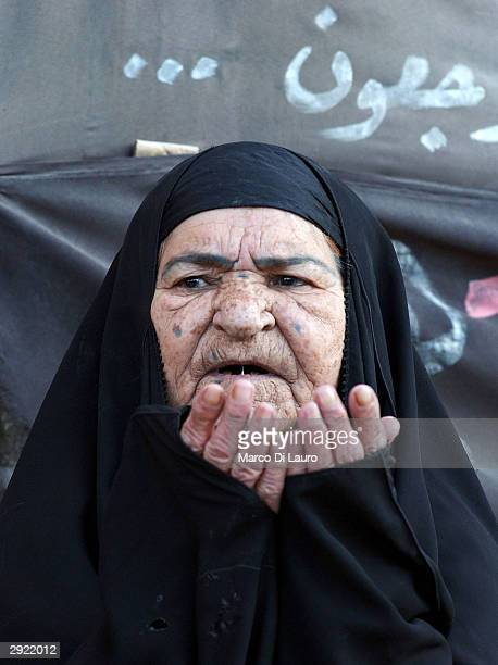 An elderly Iraqi woman prays at the shrine of Imam Ali during prayers held to celebrate Eid alAdha on February 2 2004 in Najaf 180 km south of...