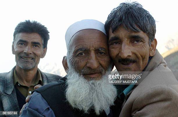 An elderly Kashmiri man is embraced by a relative in Uri some 120 kms north of Srinagar17 November 2004 after returning from Pakistan following the...