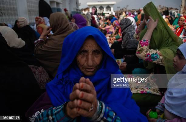 An elderly Kashmiri Muslim woman devotee prays at Hazratbal shrine to mark the anniversary of Hazrat Abu Bakr Siddiq the senior companion and the...