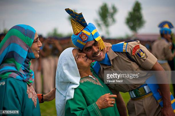 An elderly Kashmiri Muslim woman kisses her son who after the graduation ceremony on May 14 2015 in Humhama on the outskirts of Srinagar the summer...