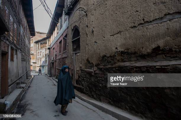 An elderly kashmiri woman walks down an alley in the old city on February 05 2019 in Srinagar the summer capital of Indian administered Kashmir India...