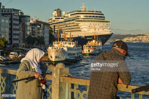 An elderly lady angles from Galata Bridge A large cruise ship is moored along the Karak_y seafront