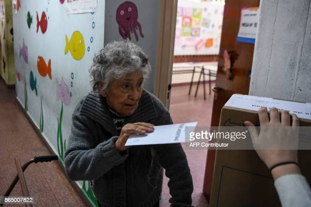An elderly lady casts her vote at a polling station during the legislative election in Buenos Aires on October 22 2017 Argentine President Mauricio...