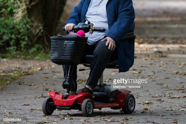 An elderly lady rides a mobility scooter outside on October 7 2018 in Cardiff United Kingdom