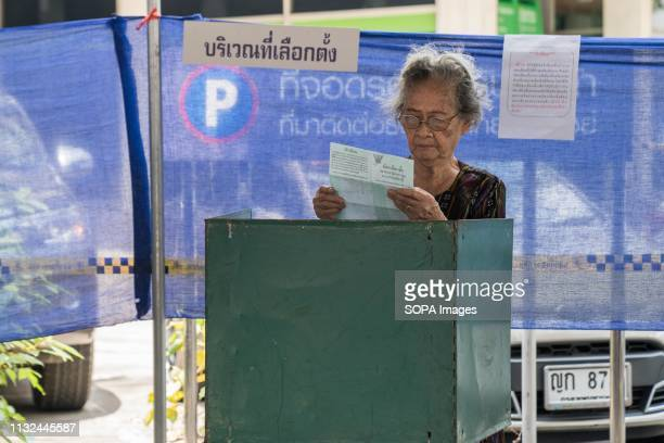 An elderly lady seen filling in her ballot paper in a polling station Thailand is hosting its first General Election in 8 years Polling stations...