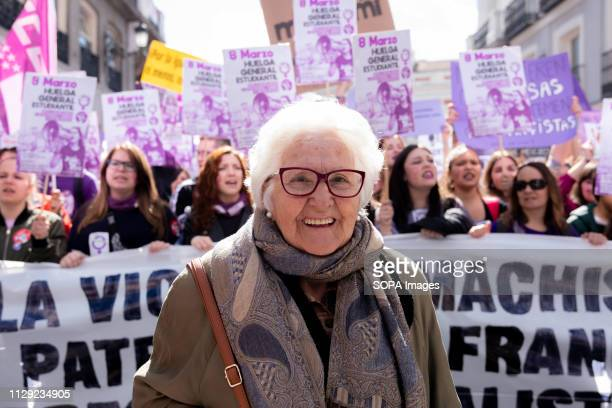 An elderly lady seen supporting the students demonstrating during women's day Spain celebrates International Women's Day with a women's general...