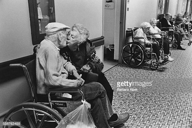 An elderly lady visits her 97yearold husband in a nursing home in Southfield Michigan November 1998 The couple are the parents of the photographer