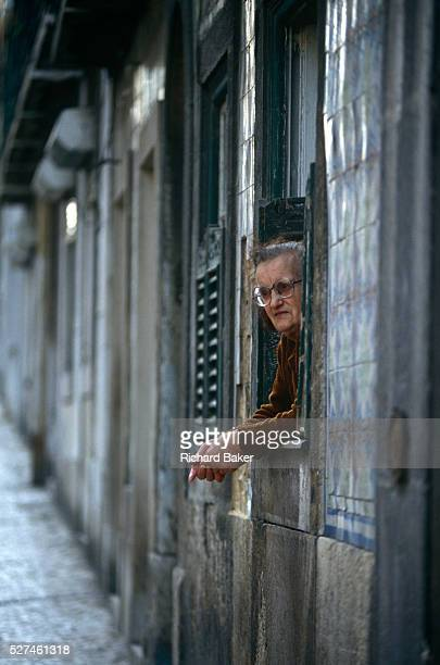 An elderly lady watches the world go by from her street doorway in Lisbon's Bica district of the Portuguese capital Looking out from her cosy small...