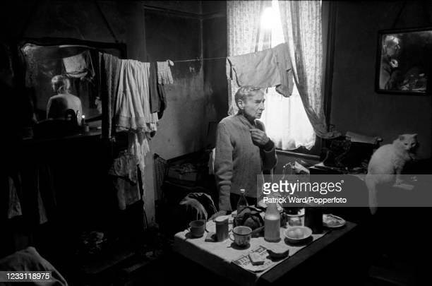 An elderly lady with her cat in her home in the East end of London, circa July 1969. From a series of images to illustrate the many frustrations of...