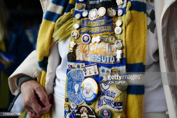An elderly Leeds supporter wears a scarf covered in memorabilia ahead of the English Premier League football match between Leeds United and West...