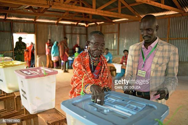 An elderly Maasai lady votes at a polling station in Saikeri Kajiado West County on August 8 2017 Kenyans began voting in general elections headlined...