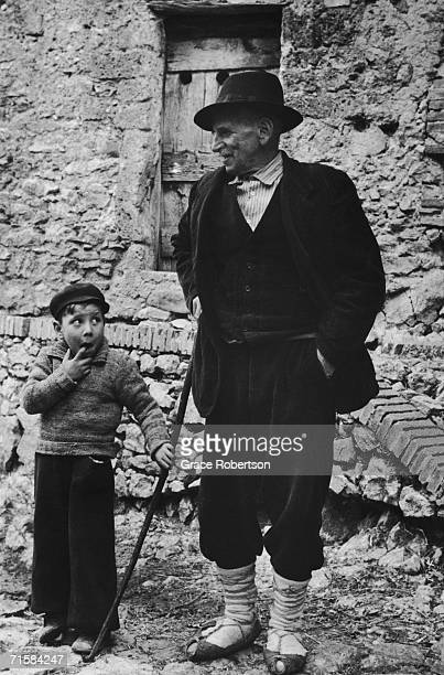 An elderly man and a boy in a village in the the Anticolana Valley Lazio Italy 1952 Original publication Picture Post 6195 Village In Italy unpub