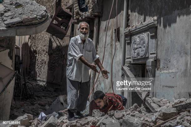 An elderly man and a disabled man ask for help from Iraqi soldiers on June 29 in Mosul Iraq The Iraqi Army Special Operations Forces and...