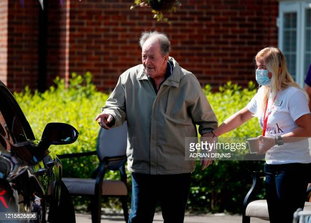 An elderly man approaches a relative's car during a drive-through visit to Gracewell, a residential care home, in Adderbury near Banbury west of...