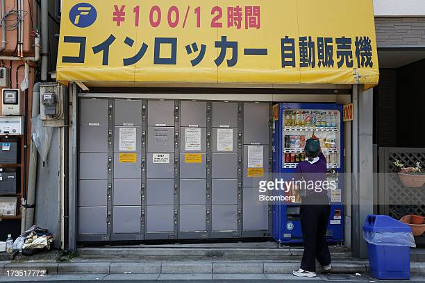 An elderly man buys a beverage from a vending machine next to baggage lockers in Tokyo Japan on Monday July 8 2013 The number of Japanese seniors...