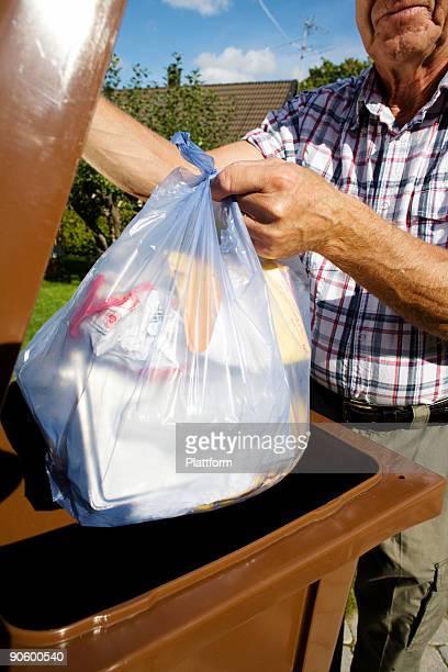An elderly man by a dustbin Sweden.