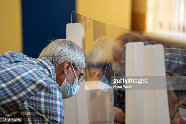 An elderly man casts his vote, during the Parliamentary Elections at a polling station on July 11, 2021 in Sofia, Bulgaria. Bulgarians will vote for...