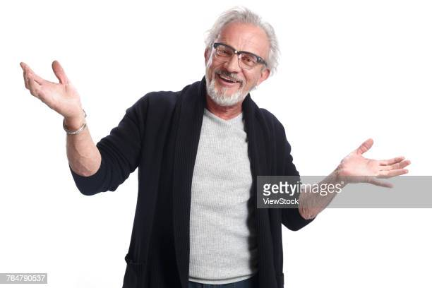 an elderly man in casual clothes - gesticular imagens e fotografias de stock