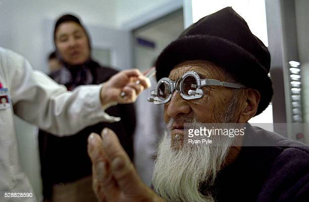 An elderly man is tested for eye glasses at the Aydia Ophthalmological Hospital in Urumqi Xinjiang in Northwestern China