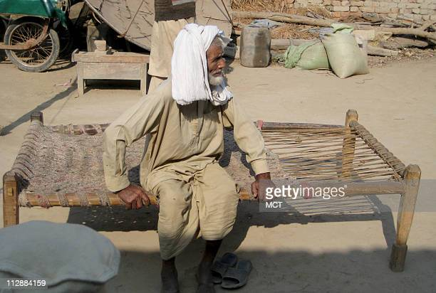 An elderly man named Sultan who identified himself as relative of Ajmal Ameer Kasab rests in the courtyard of Ajmal's family home in Faridkot village...