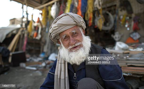 An elderly man poses for a picture in the old city of Kabul on April 11 2012 Poverty and an ongoing insurgency by the ousted Taliban still pose a...