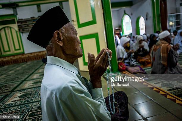 An elderly man prays at a boarding school Sepuh Payaman that cares for the elderly during Ramadan on July 15 2014 in Magelang Central Java Indonesia...