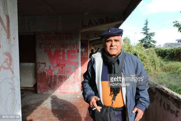 SCAMPIA NAPLES CAMPANIA ITALY An elderly man prepares to leave home In Scampia Quarter the inhabitants here an old man Vele resident building leave...
