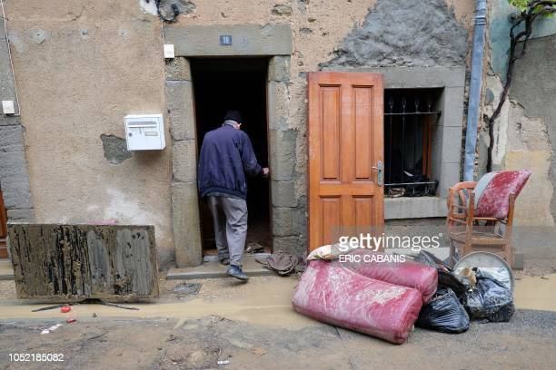 TOPSHOT An elderly man removes damaged goods from his flooded house on October 15 2018 in Villegailhenc after flash floods swamped a number of towns...