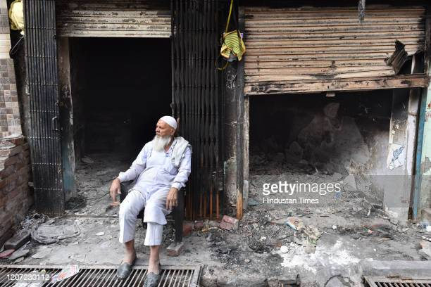 An elderly man seated outside shops burnt in the riots across North East Delhi, at Shiv Vihar, on March 15, 2020 in New Delhi, India.