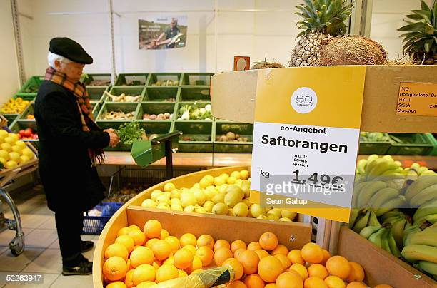 An elderly man shops for fruits and vegetables at a store of German organic supermarket chain EO Komma on March 2 2005 in Berlin Germany According to...