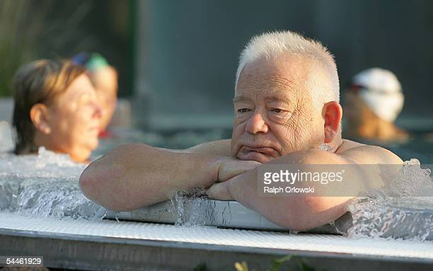 An elderly man sits in a public swimming pool on September 3 2005 in Ruesselsheim Germany Germany's economy and pension system is being burdened by...