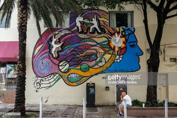 An elderly man sits under a tree in Little Havana in Miami, Florida on September 24, 2020. - The realities of Cubans and Venezuelans in Miami are so...