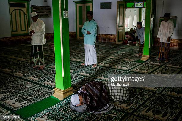 An elderly man sleeps while others pray at a boarding school Sepuh Payaman that cares for the elderly during Ramadan on July 15 2014 in Magelang...