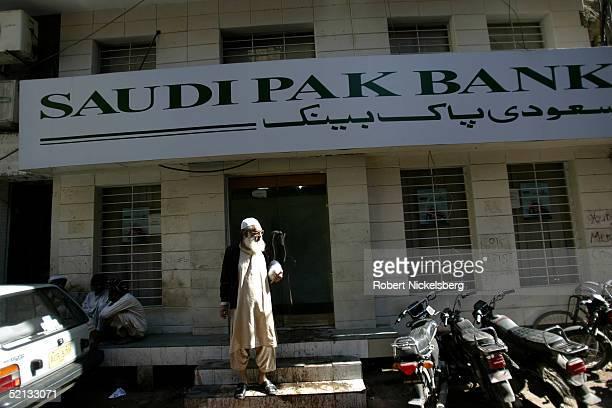 An elderly man stands in front of a branch of the Saudi Pak Bank in Jodhia Bazaar old Karachi Pakistan January 28 2005 Karachi is one of the world's...