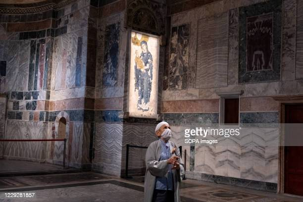 An elderly man takes photos at the Chora Mosque. After the Hagia Sophia, Chora mosque from the Byzantine period the museum status was cancelled with...