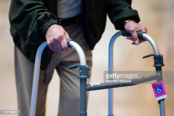 An elderly man uses a walking aid on August 14 2019 in Cardiff United Kingdom