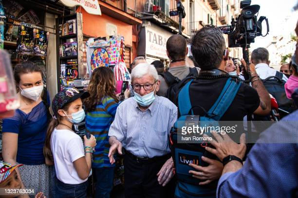An elderly man walks away from a crowd of people during Giuseppe Conte's visit on June 15, 2021 in Naples, Italy. The political head of the 5 Star...