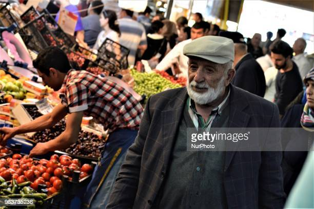 An elderly man walks in a bazaar during the Muslim holy fasting month of Ramadan in the historic Ulus district of Ankara Turkey on May 27 2018