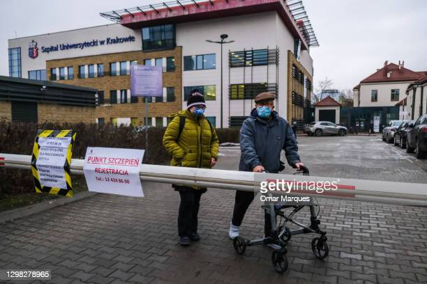 An elderly man walks way after being given a Pfizer/BioNTech COVID-19 jab at the Krakow University Hospital on January 25, 2021 in Krakow, Poland....
