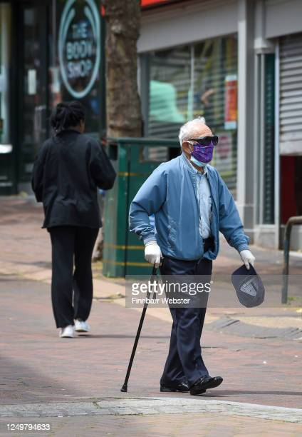 An elderly man wearing a protective face mask walks through the town centre on June 15, 2020 in Bournemouth, United Kingdom. The British government...