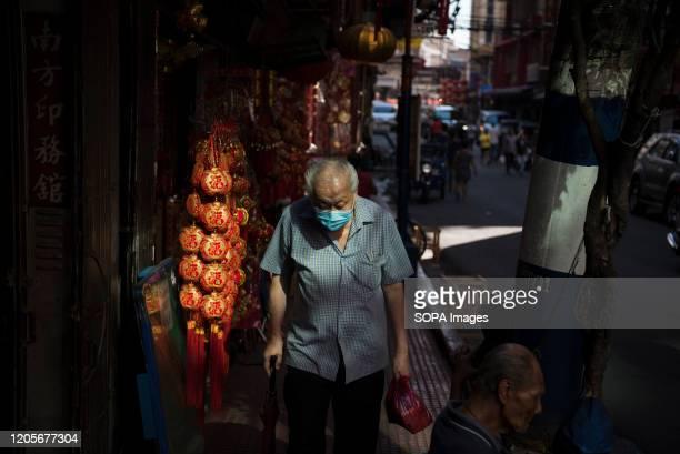 An elderly man wears a face mask as a precaution against the outbreak of Coronavirus in Manila President Rodrigo Duterte declared a state of public...